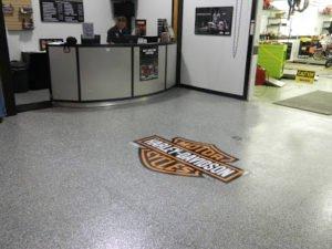 Epoxy flake floor coating with harley davidson logo in showroom