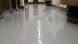 commercial bathroom with epoxy floor coating