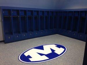 school locker room epoxy flake floor with team logo